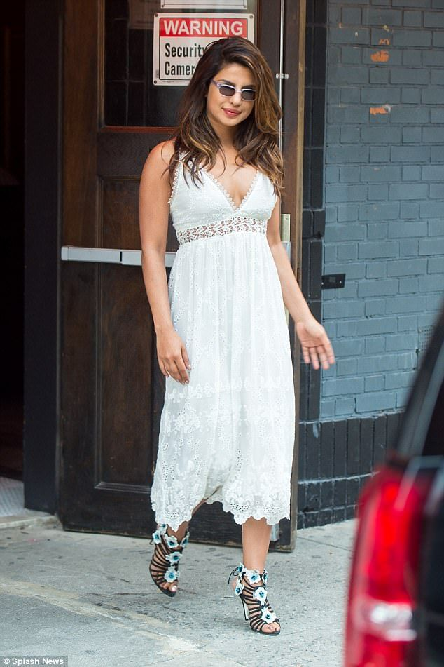 Lovely in lace! Priyanka Chopra looked in her stride as she stepped out in a white broderie anglaise dress in NYC on Thursday