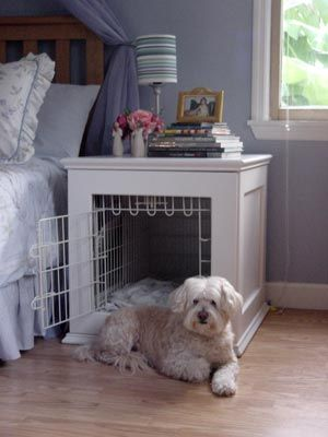 Dog crate built into bedside table.