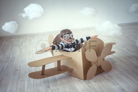Little boy in a cardboard airplane Stock Photo