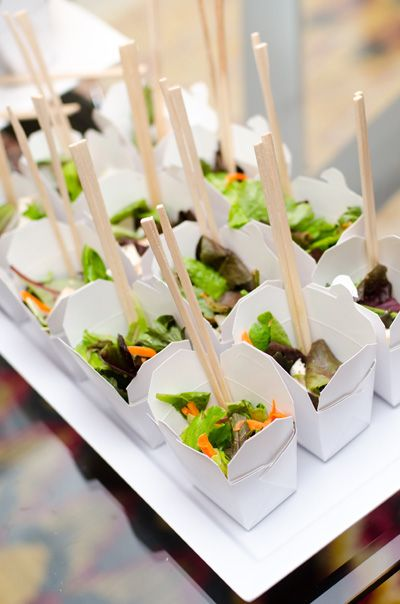 Serve salads or noodles in food cartons with chopsticks. Creative Wedding Food Presentations - Weddings Illustrated