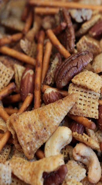TEXAS TRASH - 1/2 (14 ounce) box of Rice Chex cereal; 1/2 (14 ounce) box of Corn chex cereal (you could use wheat in place of either of these); 1/2 (1 pound) bag of pretzel sticks;1 (7.5 ounce) bag of Bugles (regular);1 regular can (8.75 ounce) of deluxe mixed nuts;  1 cup of pecans or cashews (or nut of your choice);1-1/2 sticks butter;1 tablespoon Steak Seasoning; 1 tablespoons worcestershire sauce  1 tablespoon garlic powder Preheat oven to 250 degrees. -