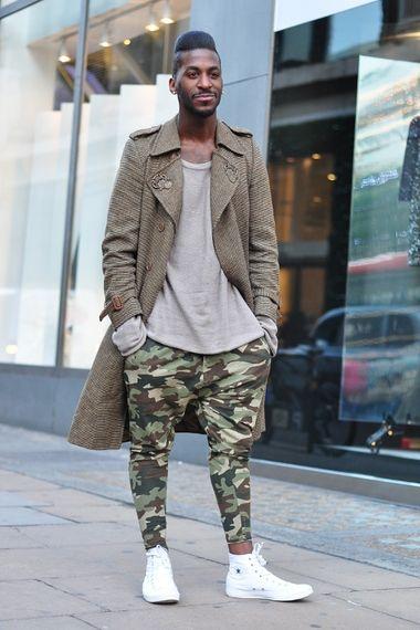 Men's camo dropcrotch pants. White sneakers. Dark green trench. https://www.lookli.st