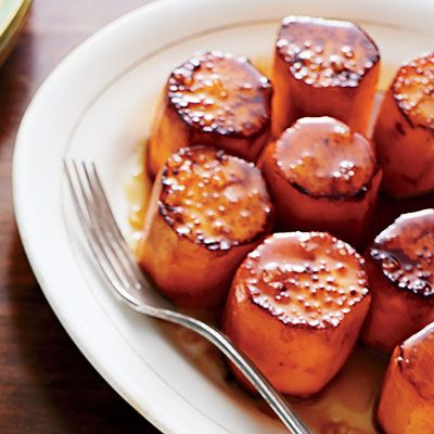 Sweet Potato Soldiers | This new take on glazed sweet potatoes looks as good as it tastes. We used the slender 'Garnet' variety commonly grown in North Carolina. If you can't find them, any petite sweet potato will work well in its place.