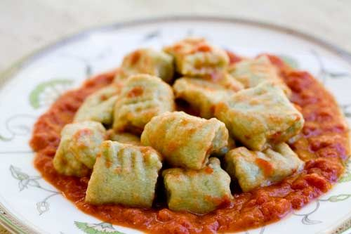 Spinach Ricotta Gnocchi ~ Spinach ricotta gnocchi, Italian dumplings made with ricotta cheese, spinach, flour, and egg, served with a tomato goat cheese sauce. ~ SimplyRecipes.com