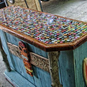 Beer Bottle Cap Tiki Bar-love this!! I have been saving bottle caps for months to do something with a table...love this idea!