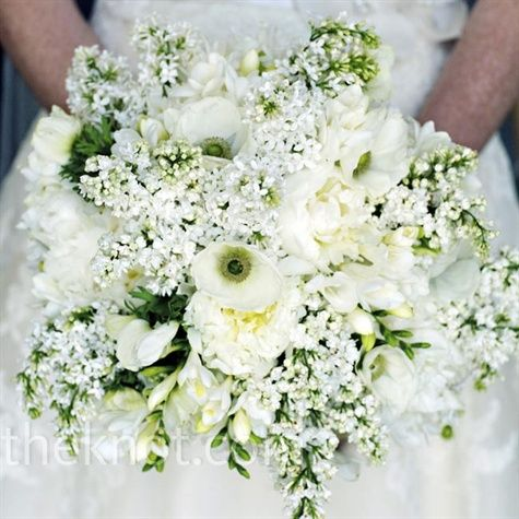 Melissa carried a wild bouquet of lilacs, peonies, anemones and freesia to complement the natural countryside.
