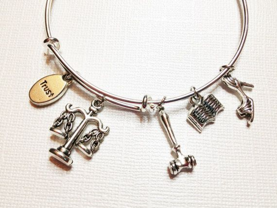 This Lawyer Theme Adjustable Bangle is the perfect gift for that special female Law student, Judge, Lawyer or Attorney in your life! Trendy, yet
