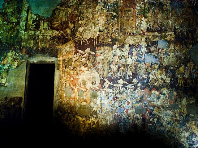 Paintings and poems are inscribed on this wall in the ajanta caves in India - the caves are over 2200+ yrs old