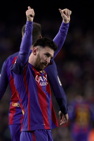 Barcelona's Argentinian forward Lionel Messi celebrates his goal during the Spanish league football match FC Barcelona vs RCD Espanyol at the Camp Nou stadium in Barcelona on December 18, 2016. / AFP / JOSEP LAGO
