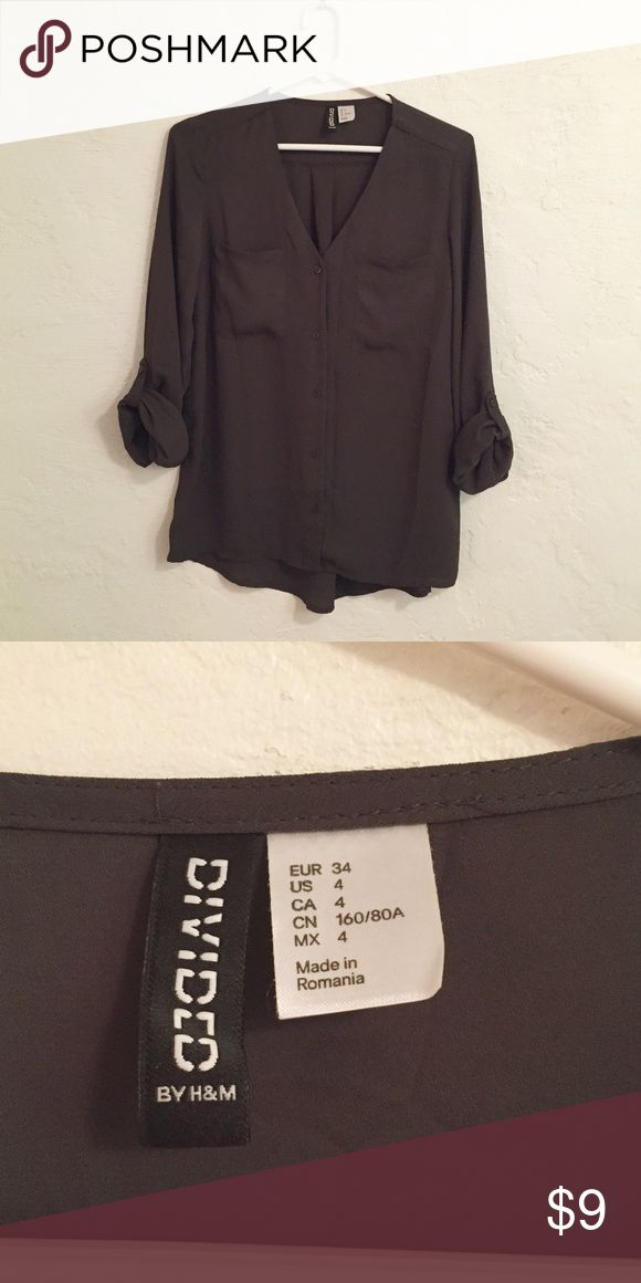 H&M dark grey blouse This dark grey blouse has roll up (with buttons) sleeves and is in EUC only worn a handful of times.  Size 4 Divided from H&M and 100% polyester.  Priced to sell - need to clean out my closet.  Please no trades or PP.  All bundles are 20% off!  Thanks for looking! Tops Button Down Shirts