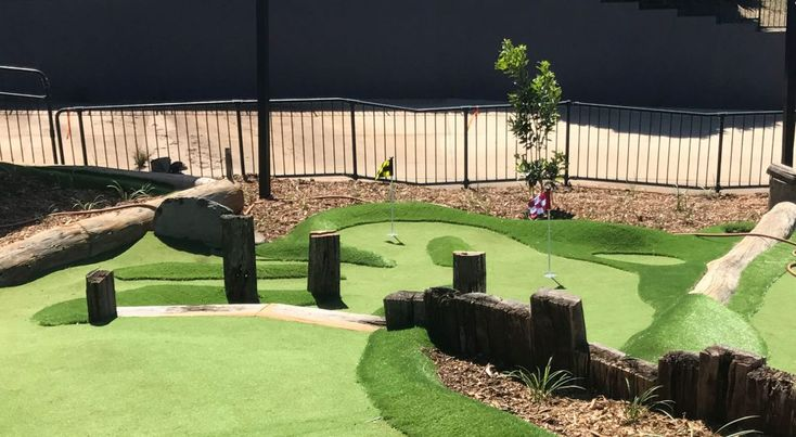 Recycled wood can be used as obstacles when building a mini golf course