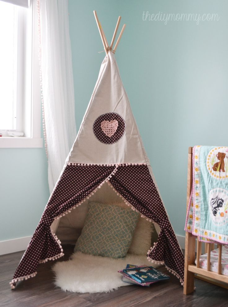 DIY Teepee Play Tent Tutorial by The DIY Mommy. All you need are dowels, a canvas drop cloth, fabric and trim!