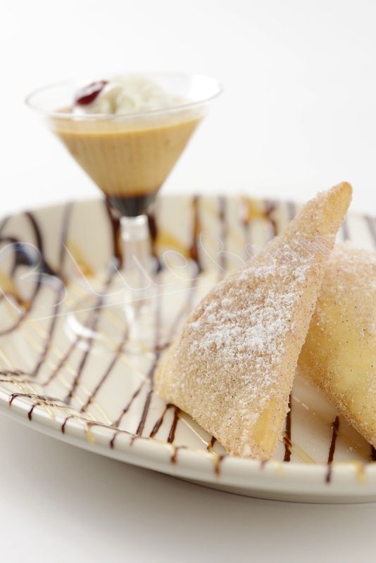 These chocolate banana empanadas are light and crisp on the outside with a warm chocolate and banana filling inside and served with whipped cream