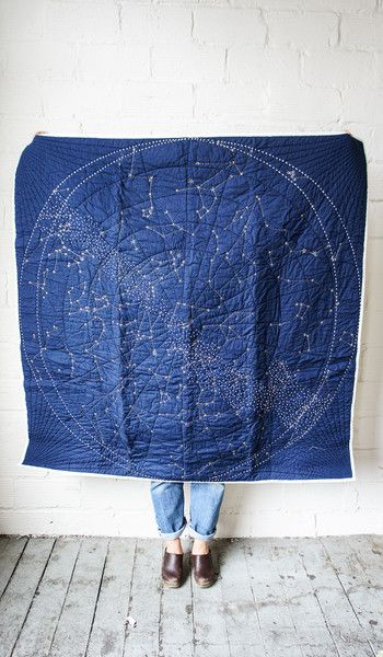 Constellation Quilt // Embroidered gold stars depict the October night sky around the 40th parallel in the Northern Hemisphere and feature constellations like the Big and Little Dipper, Gemini, Orion, Leo, and Taurus.