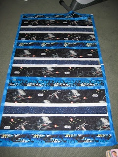 Star Wars quilt ... cool idea for a certain grandson ... perhaps cut the fabrics into blocks and set with sashing & cornerstones