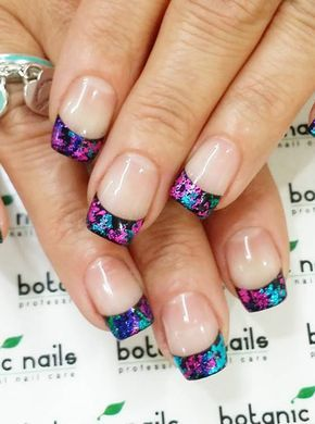 Colorful glitter French tips. Who says that French tips need to be in one color? Play around with bold and dark colors in glitter nail polish to make them stand out.