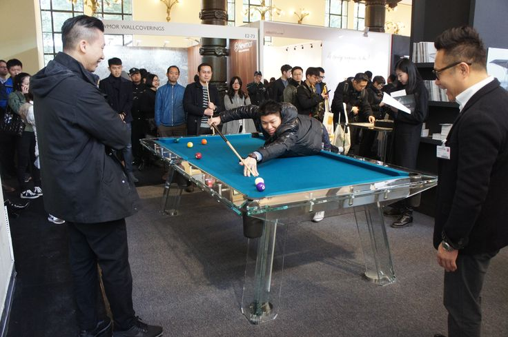 Chinese are playing on Impatia's Filotto american pool table made of crystal glass. Wow!