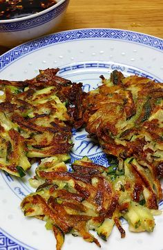 Korean Zucchini Pancakes a.k.a Zucchini french fries may turn your picky vegetable eaters into zucchini lover!! http://www.chinesefoody.com/korean-zucchini-pancakes/