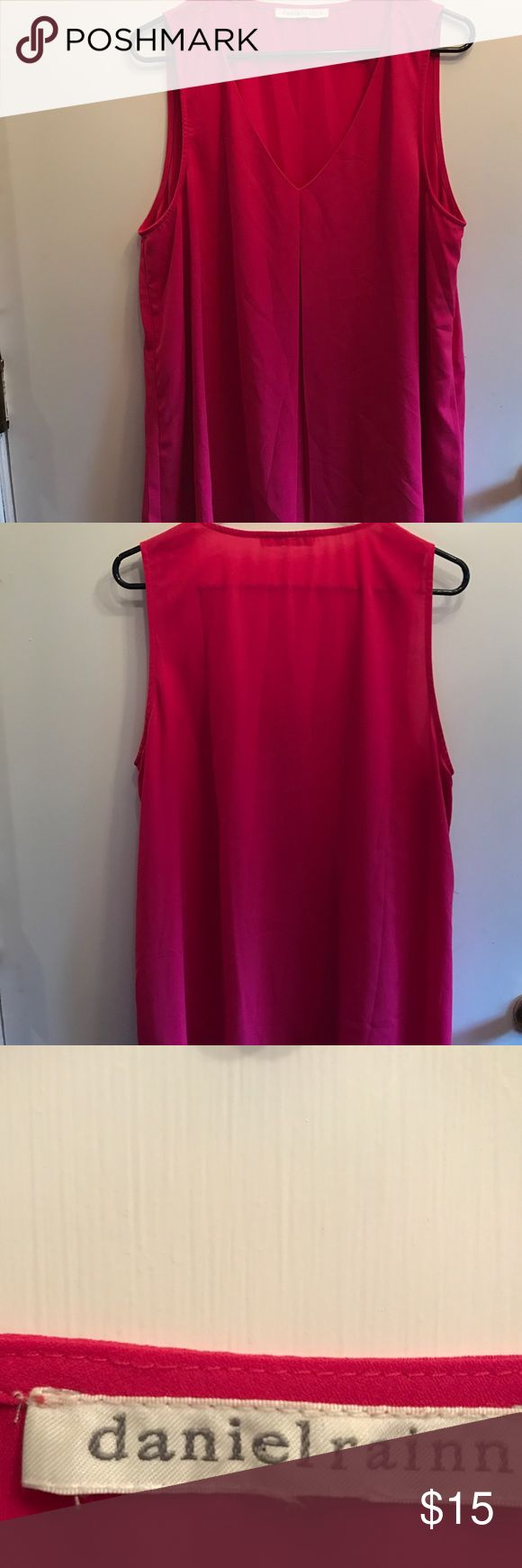 Daniel Rainn XL fuchsia hot pink short sleeve top. Daniel Rainn XL fuchsia hot pink short sleeve top. Inverted pleat in front. Can be worn with shorts, jeans, skirt or as a shell under a suit. Loose fitting, perfect for spring & summer days! Polyester blend. In Perfect condition. No trades. Daniel Rainn Tops Blouses