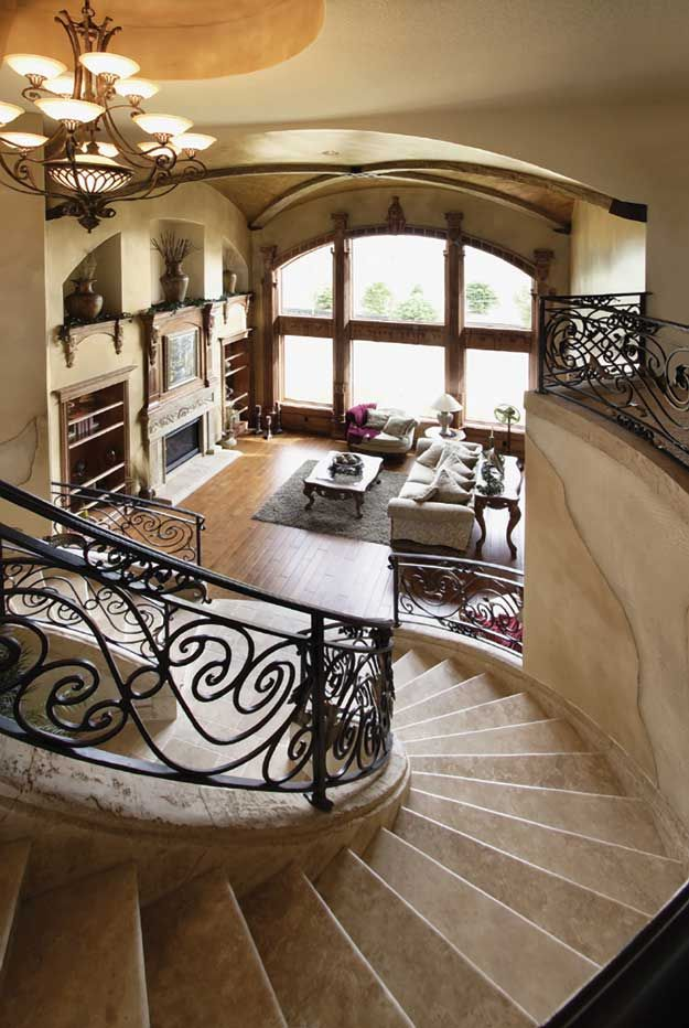 Spiral stairs into the living area. Mediterranean  House Plan # 221155.