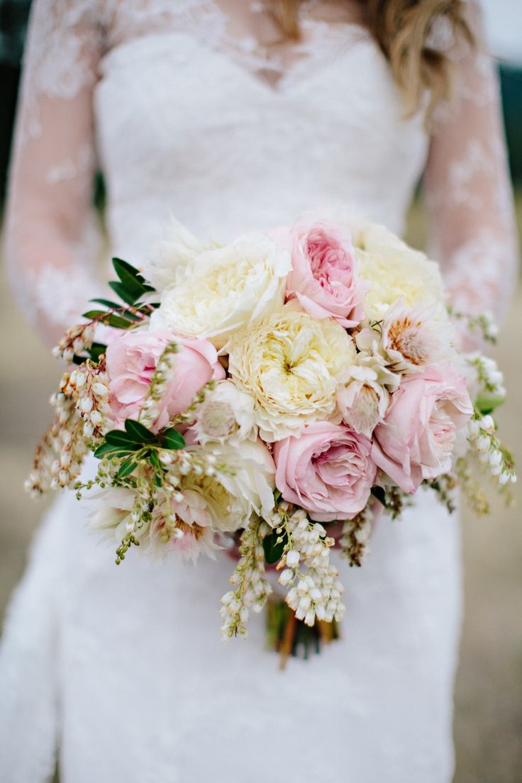 Pink and ivory garden rose bouquet. Photography: Green Door Photography - www.greendoorphotography.com/ Read More: http://www.stylemepretty.com/2014/08/18/greenough-montana-wedding-by-habitat-events/