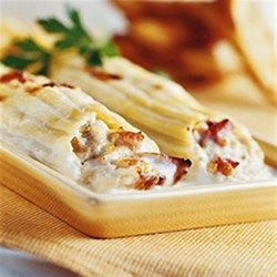 With prepared grilled chicken strips, classic chicken manicotti filled with Parmesan cheese, ricotta, chopped chicken and more are baked in a creamy sauce for an easy and impressive dinner.