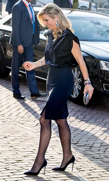 Here's a great way to add texture to a simple skirt. Queen Maxima of the Netherlands was standing tall in stilettos and a pencil skirt for an evening at the ballet with Argentina's President Mauricio Macri and his wife Juliana Awada in March 2017 in The Hague. What makes the outfit, though, is the royal's velvet top combined with sparkling jewels.