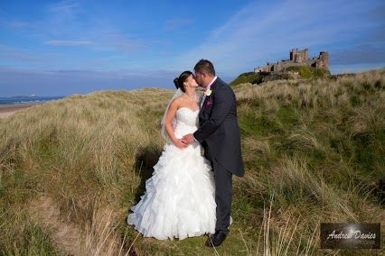 wedding photographers northumberland www.andrew-davies.com took this fab photo with Bamburgh Castle as the backdrop in 2013