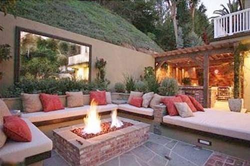 Outdoor living room built into hillside
