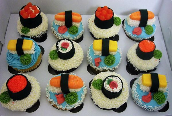 Sushi Cupcakes for brad's party....use white sprinkles, swedish fish, gum drops, starburst etc.