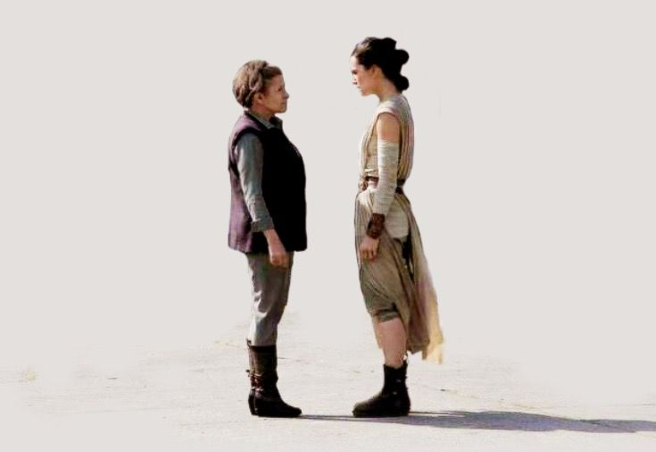 carrie fisher as leia organa and daisy ridley as rey