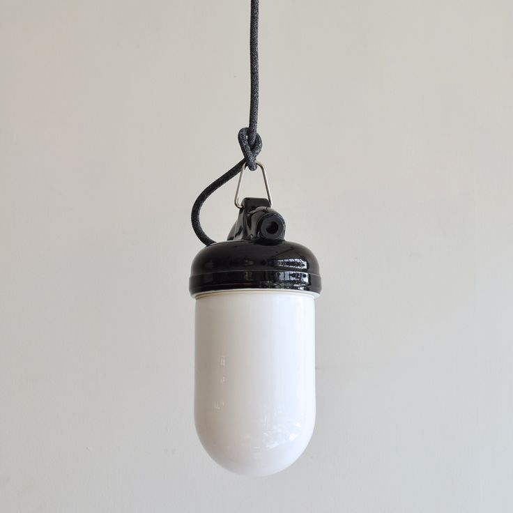 £95 this is a certified contemporary bathroom pendant with white glass shade and polished black