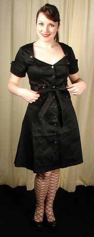 In the Service Military Dress:Looking for an updated take on a simple shirt dress? Look no further! This is dress has vintage looking buttons all the way down the front, no more struggling with a back or side zipper, short cuffed sleeves, faux flap pockets on the front, trim around your bust-line to accentuate--well your bust, empire waist, a matching fabric tie belt and...