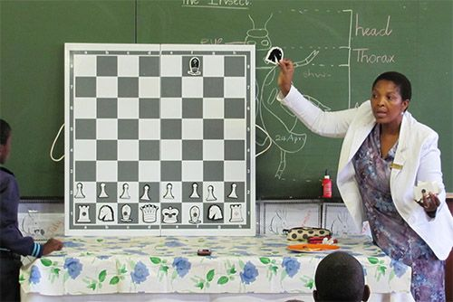 Pioneering chess in rural KZN, South Africa – Ulundi & Richards Bay                         http://movesforlifeblog.files.wordpress.com/2014/05/teacher-in-front-of-class.jpg