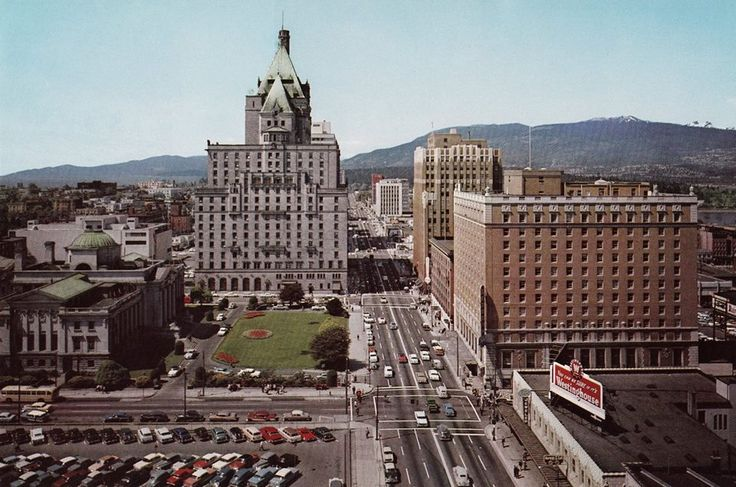 Taken from the original Birks Building at Georgia and Granville. The parking lot is where the old Hotel Vancouver used to be and developed into Pacific Centre in 1969-1971. Devonshire Hotel was blown up in 1980. Georgia Medical-Dental building was blown up in 1990. Trump tower is presently under construction where that white cube-shaped building is down the street. Bentall Centre at Burrard began development in '69.
