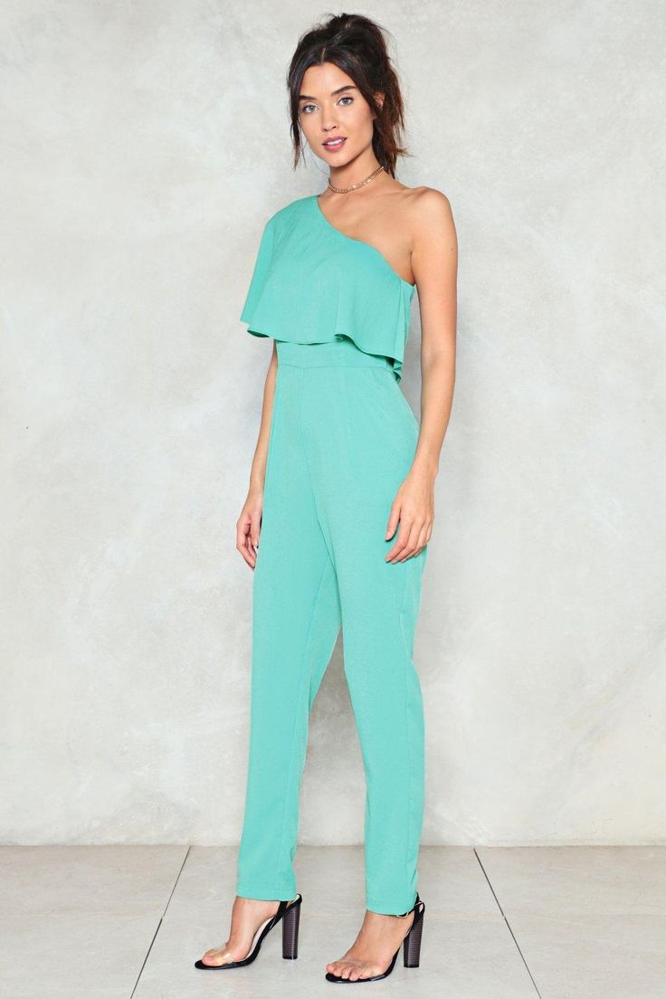 Making super star moves. The One Hit Wonder Jumpsuit features a one shoulder, tailored silhouette, ruffle detailing, and zip closure at side.