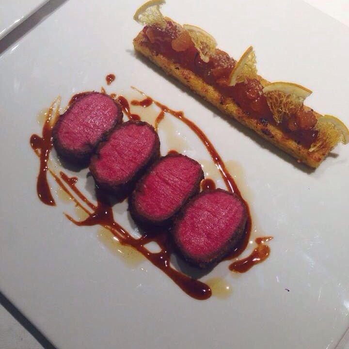 Sous vide müeslix crusted lamb loin, polenta, apricot marmalade, candied orange, lamb jus. #chefjaimec