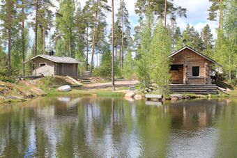 Smoke sauna with barbeque place, Lohja A smoke sauna by a pond, which gets its water from a natural spring. There is a roomy summer kitchen for cooking by open fire. It is relaxing to sit on the stairs of the sauna after swimming and soft heat of the smoke sauna.