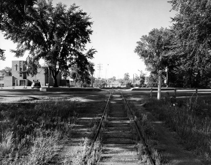 This was the scene in 1955 before the railway tracks were removed near Island Park. That's the Kitchissippi United Church in the background. Photo courtesy of the City of Ottawa archives (CA-24213). Click image to enlarge.