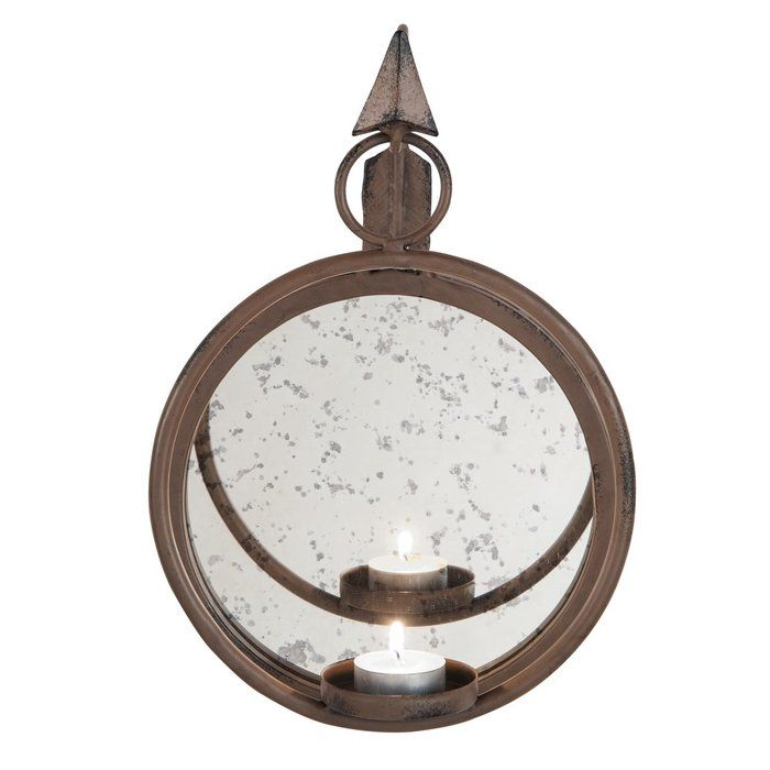 The Arrow Metal Sconce is the perfect piece to flank southwestern or mission style artwork, line a hallway and decorate a bathroom. The bronzed metal encases a circular antiqued mirror.