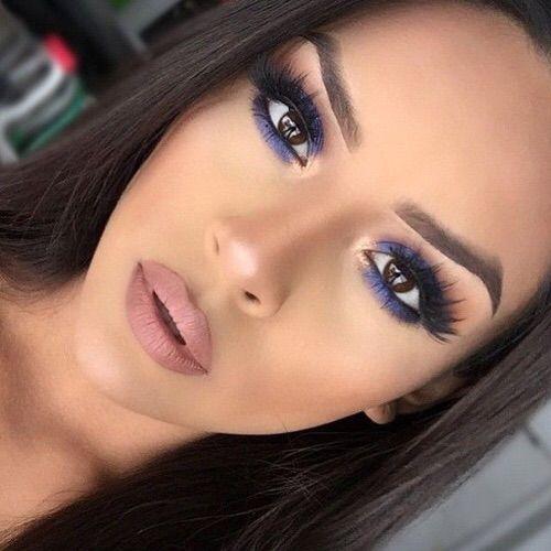 Navy blue eye makeup & nude lips.
