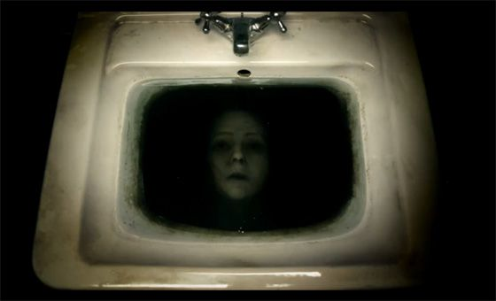 Sink a doll head or mask in inky water.
