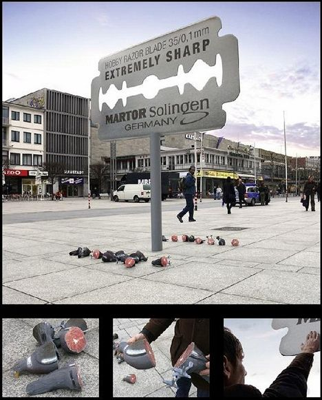 """Pigeons vs. razors. German razor company Martor Solingen """"demonstrated"""" the sharpness of their product with this clever billboard, strewing the ground around it with sliced-up rubber pigeons."""