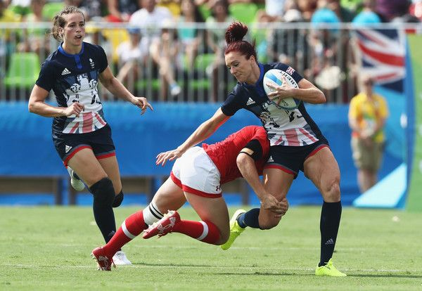 Joanne Watmore of Great Britain runs with the ball under pressure during the Women's Pool C rugby match against Canada on Day 2 of the Rio 2016 Olympic Games at Deodoro Stadium on August 7, 2016 in Rio de Janeiro, Brazil.