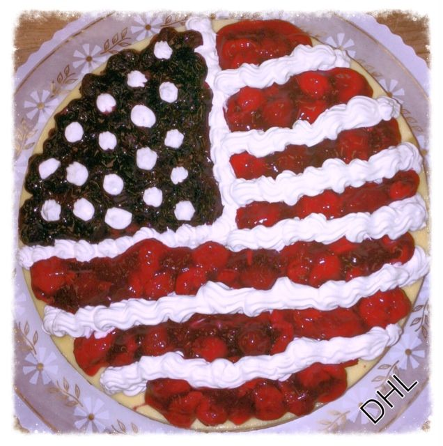 Star Spangled Cheesecake. Celebrate Independence day with our famous New York style Cheesecake festooned with our homemade cherry and blueberry topping, and topped with whip cream.This will be the hit of your Fourth of July celebration!