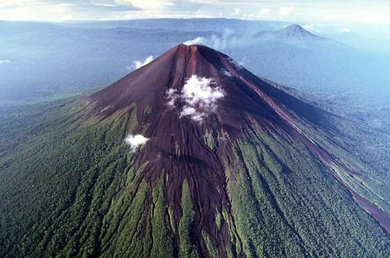 """ULAWUN, PAPUA NEW GUINEA Several thousand people live near the Ulawun volcano, so beware if you reside close by. Since the 18th century, there have been 22 recorded eruptions. Volcano Live explains, """"Ulawun volcano is composed of lava flows interbedded with tephra composed of basalt and andesite."""""""