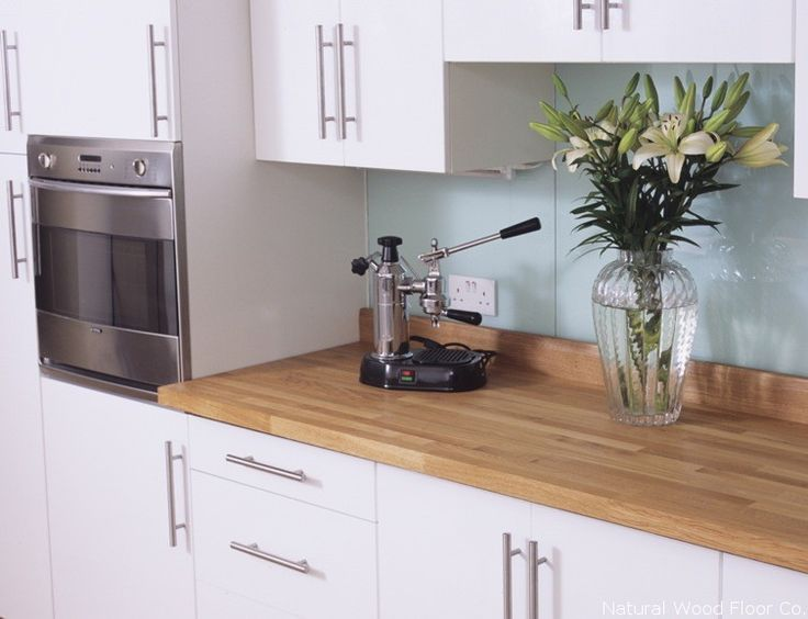 Oak Worktop, white units and pale green tiles, love this kitchen!