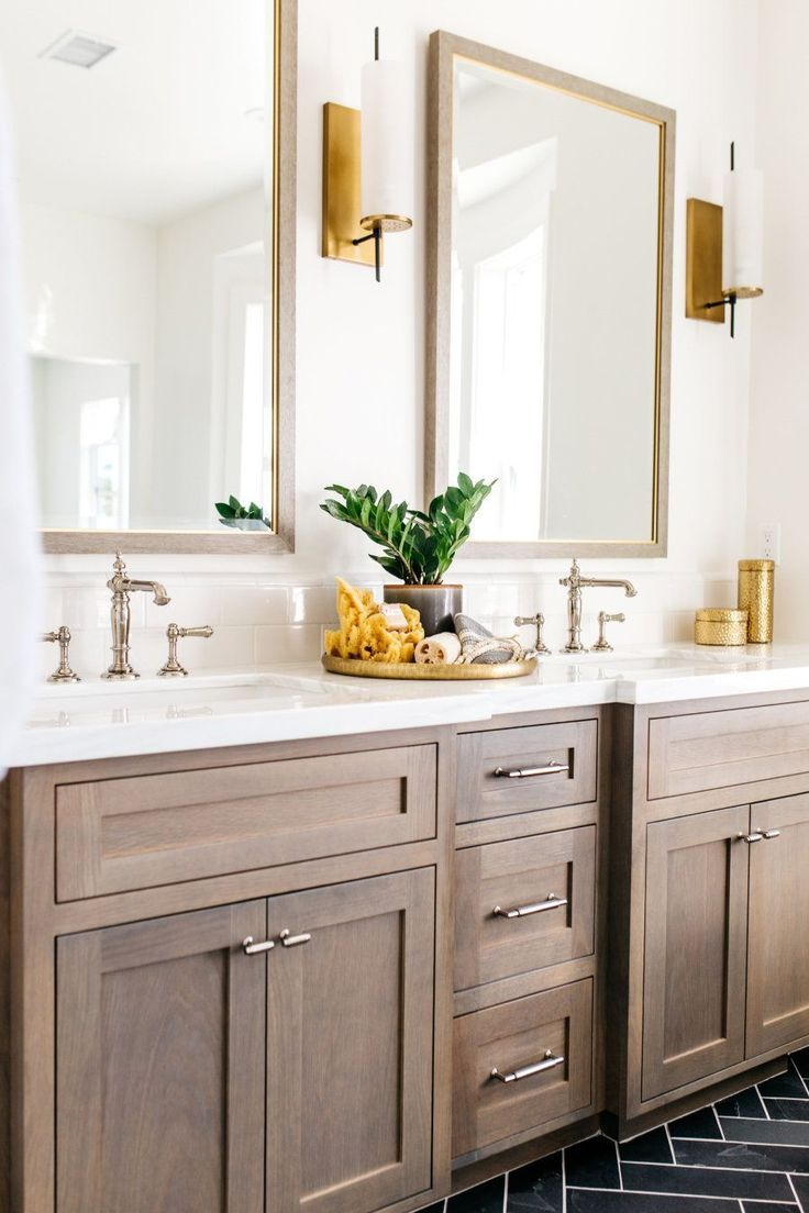 Wood Bathroom Cabinets With Gold Accents And Slate Herringbone