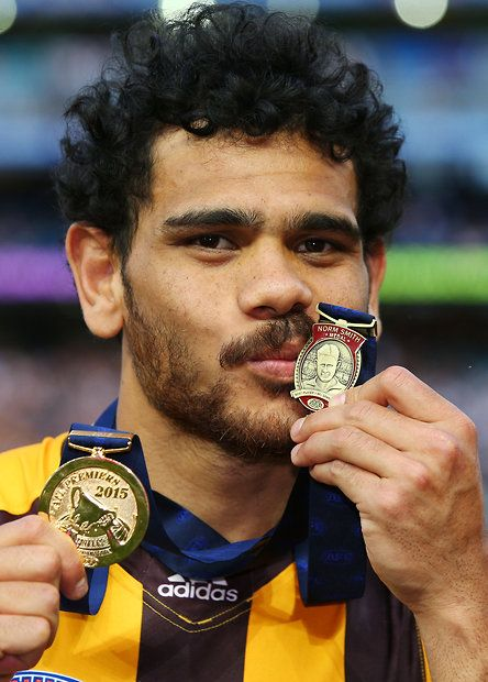 2015 Toyota AFL Grand Final - Hawthorn v West Coast - Cyril Rioli of the Hawks kisses his Norm Smith medal