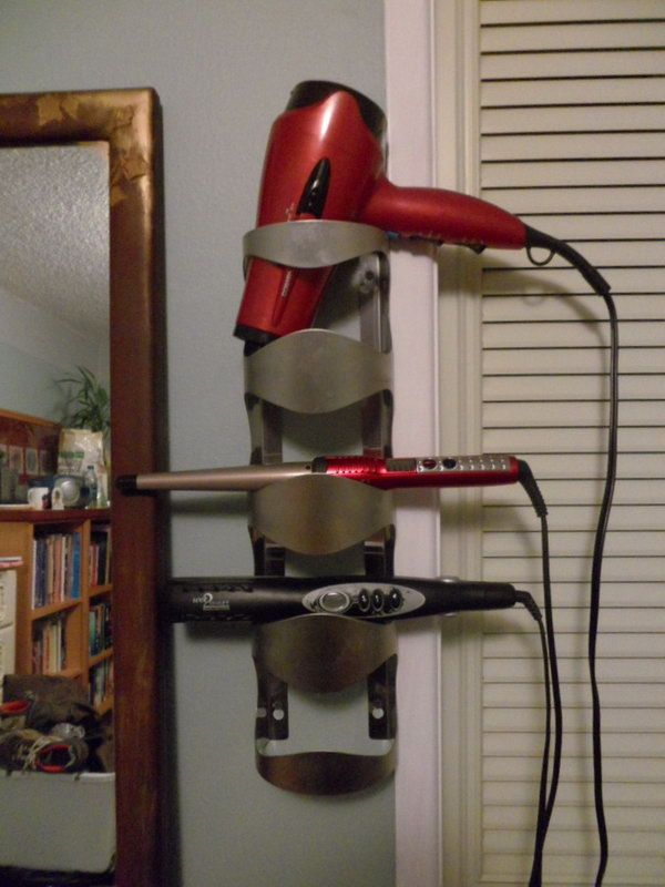 Wine Bottle Hair Dryer Organizer. Turn your old wine bottle holder into a useful hot tools storage. http://hative.com/creative-hair-dryer-and-curling-iron-storage-ideas/